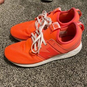 Hot pink/ orange new balance shoes